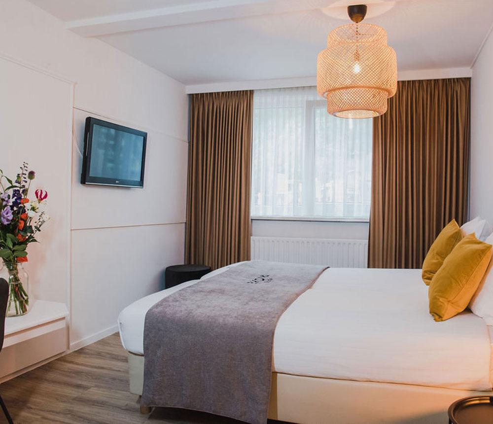 De kamers van Hotel Riche zijn van alle gemakken voorzien